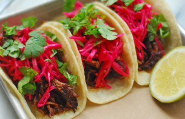 close up image of the #bartacosecret ancho-braised beef taco, now available at order.bartaco.com