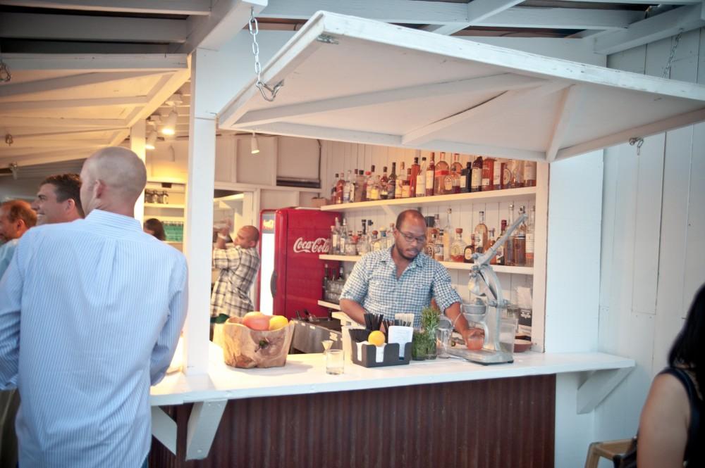 Bartender preparing drinks at bartaco